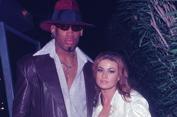 Image of Dennis Rodman with his wife Carmen Electra