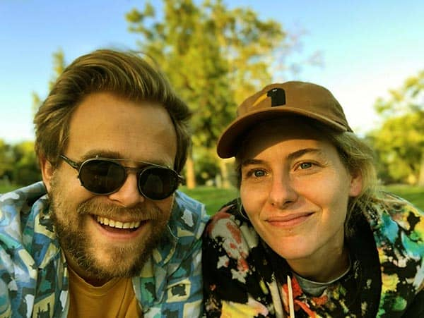 Image of Adam Conover with his wife Lisa Hanawalt